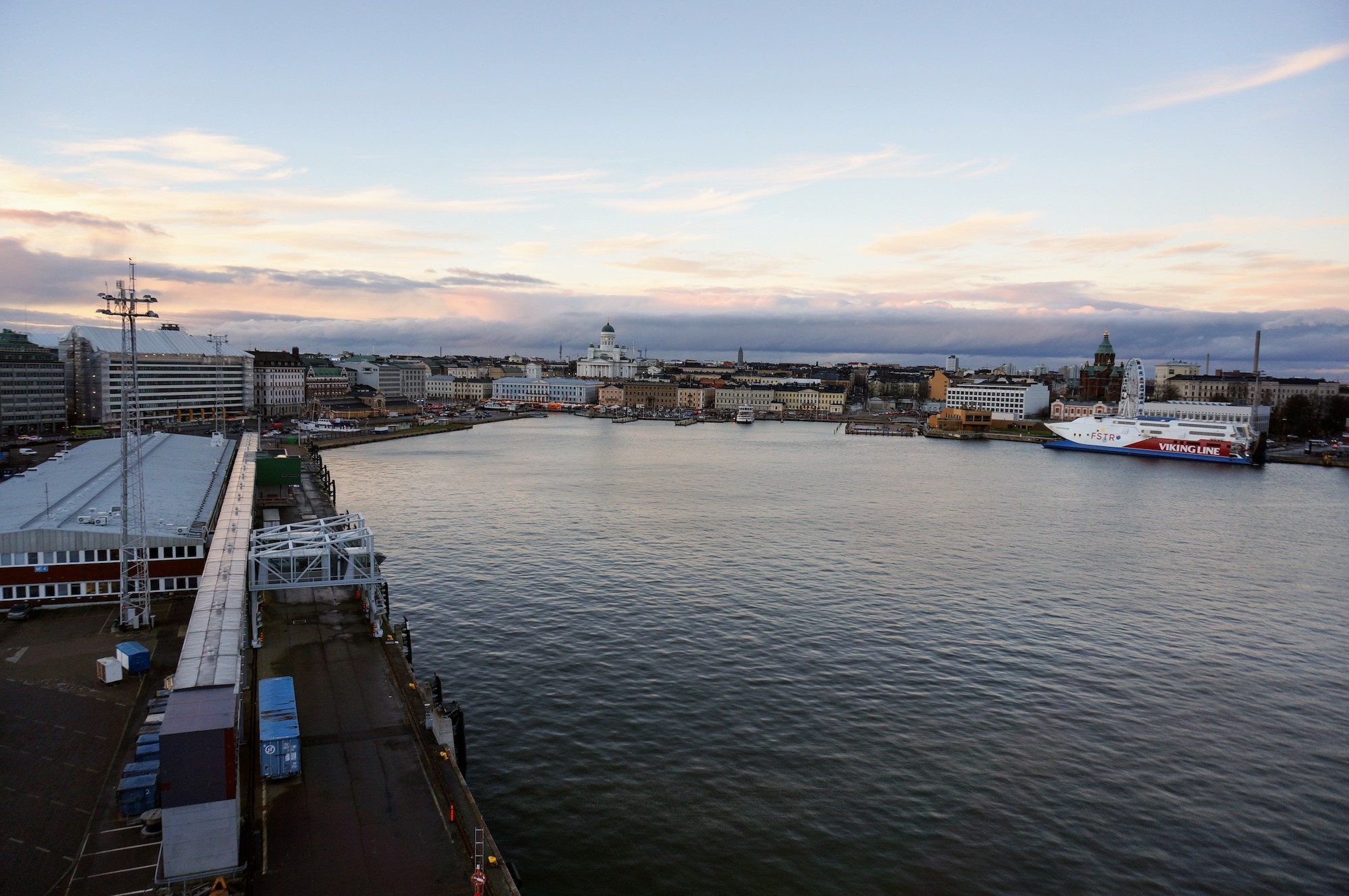 Aboard a ferry docked at Olypmia Terminal, towards the left is Makasiini terminal, and to the right, a Viking Line ship docked at Katajanokka.
